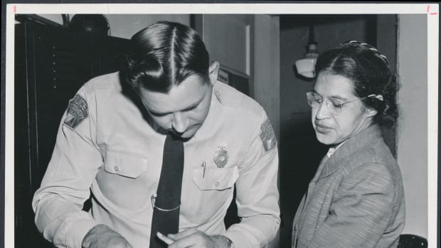 Rosa Parks being fingerprinted by Deputy Sheriff D.H. Lackey after being arrested for boycotting public transportation in Montgomery, Alabama, in February of 1956.