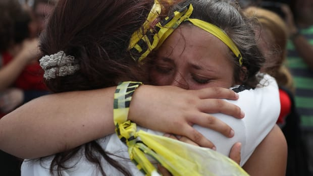 Madison Fox is hugged as the West Boca High School student joined hundreds of fellow students that walked to Marjory Stoneman Douglas High School in honor of the 17 students shot dead on February 20th, 2018, in Parkland, Florida.
