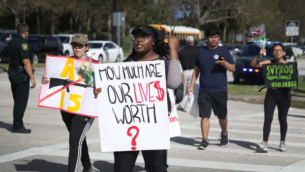Students arrive at Marjory Stoneman Douglas High School after marching from Deerfield Beach High School on February 23rd, 2018, in Parkland, Florida.