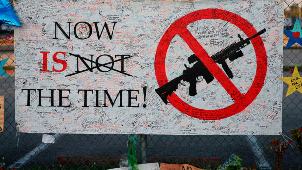 A sign hangs on a fence at Marjory Stoneman Douglas High School in Parkland, Florida, on February 27th, 2018.