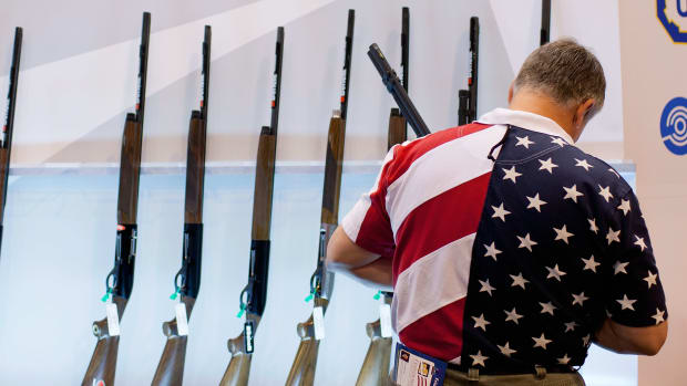 A man looks at the Benelli display of shotguns during the NRA Annual Meetings and Exhibits convention on April 13th, 2012, in St. Louis, Missouri.