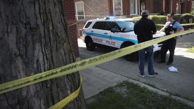 Chicago Police guard evidence near a murder scene in the Humboldt Park neighborhood on July 27th, 2017, in Chicago, Illinois.