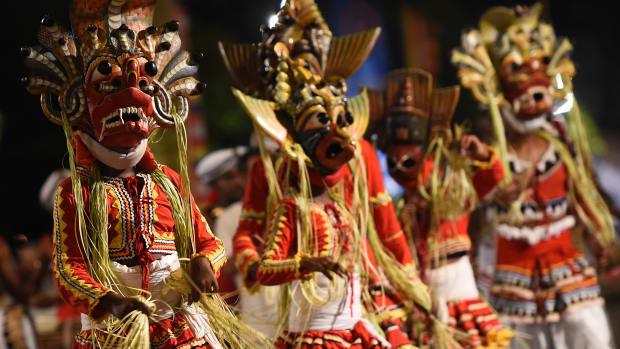 Traditional Kandyan dancers perform during a procession in front of the Gangarama Temple in Colombo, Sri Lanka, on March 1st, 2018, during the Navam Perahera Festival, the city's biggest two-day annual Buddhist procession.