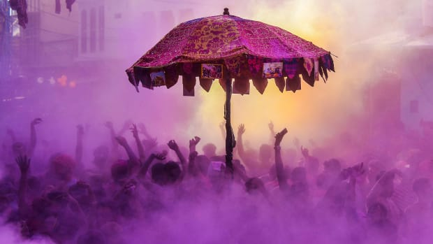 "Indian devotees and foreign tourist take part in the ""kapda phaar,"" or cloth tearing, during Holi festival celebrations in Pushkar, in the Indian state of Rajasthan, on March 2nd, 2018. Holi, the popular Hindu spring festival of colors, is observed in India at the end of the winter season on the last full moon of the lunar month."