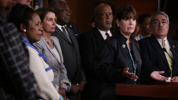 Flanked by other House Democrats, U.S. Representative Betty McCollum, center, speaks as House Minority Leader Nancy Pelosi listens during a news conference about the Confederate flag on July 9th, 2015, in Washington, D.C.