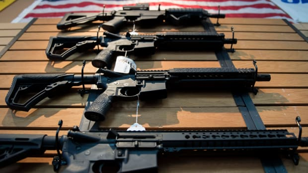 Assault rifles hang on the wall for sale at Blue Ridge Arsenal in Chantilly, Virginia, on October 6th, 2017.