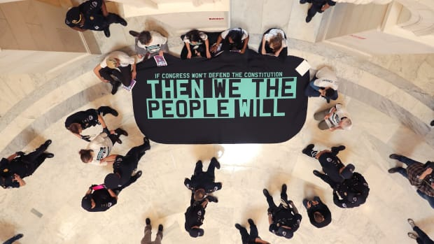 Demonstrators from the pro-impeachment group By the People rally in the Cannon House Office Building Rotunda on Capitol Hill on May 14th, 2019, in Washington, D.C. About 10 members of the protest group were arrested by U.S. Capitol Police while demanding that impeachment proceedings against President Donald Trump begin immediately.