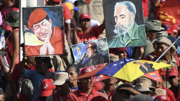 Portraits depicting late Venezuelan President Hugo Chávez and the late Cuban leader Fidel Castro on display during a May Day rally in Caracas, Venezuela, on May 1st, 2019.