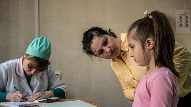 Katya Ganiyeva tends to her daughter Alisa Ganiyeva, age six, who is about to receive a measles vaccine shot from nurse Mariana Gonchara at a health clinic on May 15th, 2019, in Kiev, Ukraine. Ukraine is struggling with its largest measles outbreak in decades, with more than 34,000 confirmed cases so far this year, according to the World Health Organization.