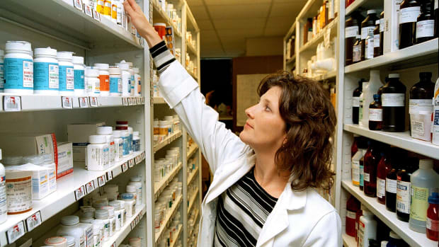 Jennifer Boudreaux, co-owner of The Compounding Pharmacy in Shreveport, Louisiana, searches for the generic brand of a drug to fills a customers prescription, on Monday October 21st, 2002.