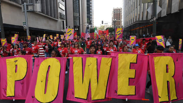 Union members, activists, and their supporters march through Los Angeles during their annual May Day procession in support of workers' rights and immigrant freedom on May 1st, 2019.