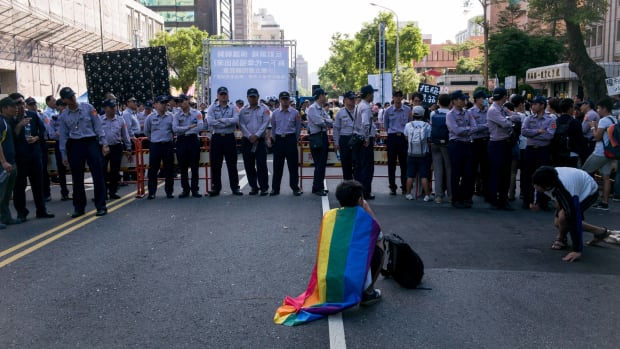 A supporter of same-sex marriage wears a flag during a 2016 protest in Taipei, Taiwan.