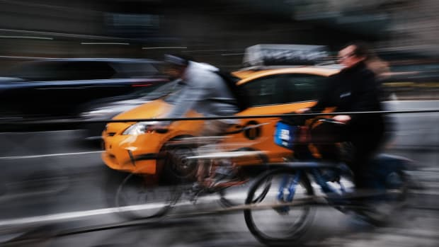 Cars and bicyclists travel on a busy Manhattan street on April 2nd, 2019, in New York City. In an effort to ease traffic delays and to increase funding for public transportation, New York City has passed a plan for congestion pricing for all vehicles traveling into Manhattan south of 61st Street.