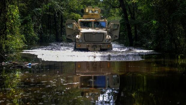 A tactical vehicle drives through floodwater in Florence County, South Carolina.