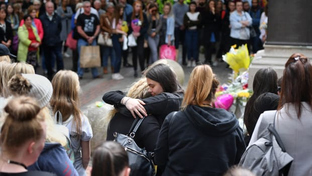 Two women hug while a two-minute silence is observed in memory of the victims of the Manchester Arena Bombing in Saint Anne's Square on May 22nd, 2019, in Manchester, England. The suicide bomb attack took place following a concert at Manchester Arena by singer Ariana Grande and claimed the lives of 22 people.