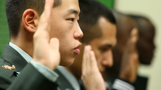 U.S. Army Private First Class Sung Kuyn Chang is sworn in with other members of the armed forces to become new U.S. citizens during a 2010 naturalization ceremony at the U.S. Citizenship and Immigration Services office in Fairfax, Virginia.