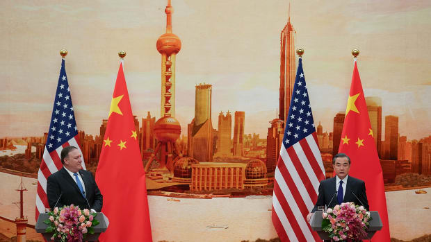 Chinese Foreign Minister Wang Yi (R) speaks during a press conference with U.S. Secretary of State Mike Pompeo.