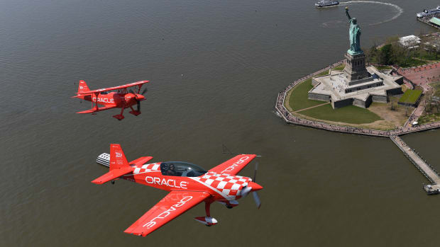 Aerobatic pilots Sean D. Tucker and Jessy Panzer (foreground) of Team Oracle fly down the Hudson River past the Statue of Liberty on May 22nd, 2019, during a media day in advance of the Bethpage Air Show at Jones Beach over Memorial Day weekend.