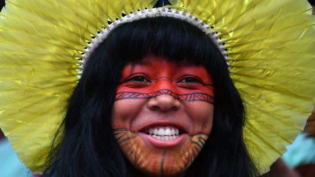 A Brazilian indigenous young woman marches along Paulista Avenue during the commemoration of the International Women's Day in Sao Paulo, Brazil.