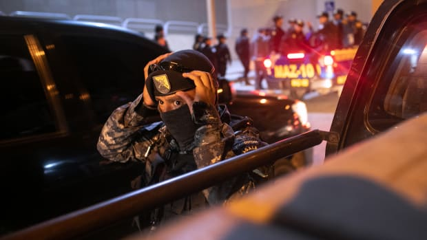 A Guatemalan policeman prepares to take part in an early morning raid during which a suspected human trafficker was taken into custody on May 29th, 2019, in Guatemala City. United States Department of Homeland Security agents accompanied Guatemalan police on the raid, the first since acting Secretary of Homeland Security Kevin McAleenan signed an agreement with his Guatemalan counterparts, increasing cooperation on human and drug smuggling. McAleenan is on a four-day trip to Guatemala.