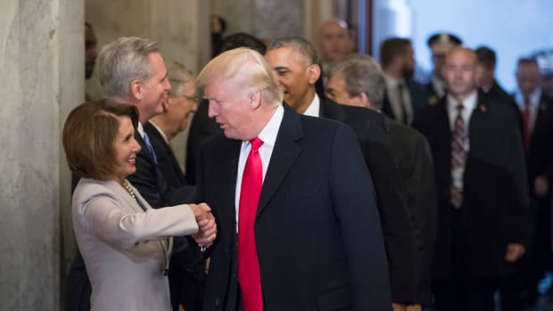Nancy Pelosi greets Donald Trump ahead of his inauguration ceremony in 2017.
