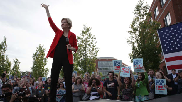 Democratic presidential hopeful Senator Elizabeth Warren waves during a campaign town hall at George Mason University on May 16th, 2019, in Fairfax, Virginia.