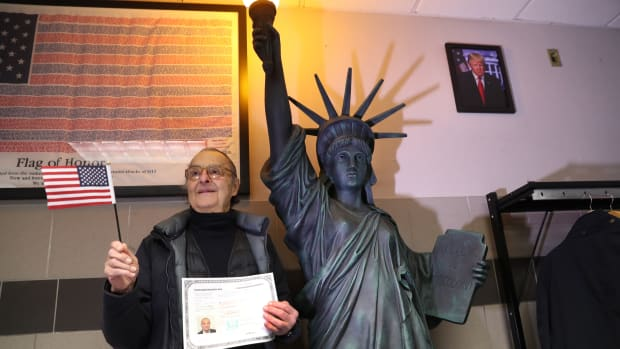 A new American citizen poses for photos following a naturalization ceremony on February 2nd, 2018, in New York City.