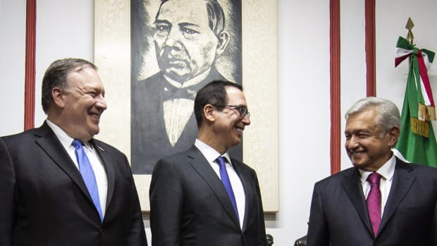 U.S. Secretary of State Mike Pompeo and Secretary of the Treasury Steven Mnuchin speak with then-President-elect of Mexico Andres Manuel Lopez Obrador in July of 2018.