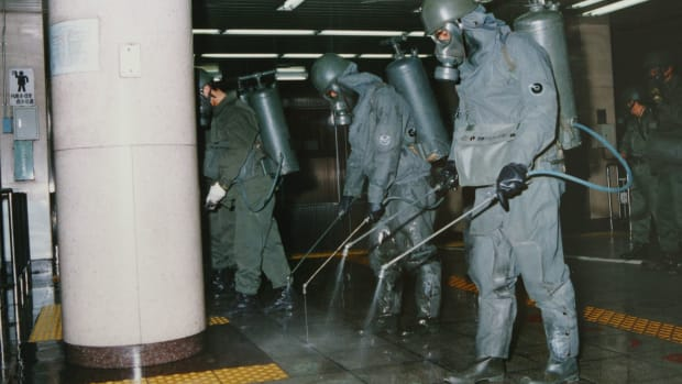 In this handout from the Japanese Defense Agency, personnel are seen clearing sarin off platforms after the 1995 gas attack on Tokyo's subways.