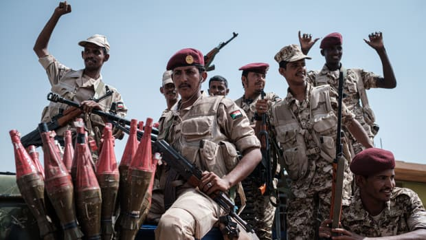 Members of Sudan's Rapid Support Forces, led by General Mohamed Hamdan Dagalo (deputy head of Sudan's ruling Transitional Military Council and commander of the paramilitaries, also known as Himediti), stand guard during the general's meeting with his supporters in Khartoum on June 18th, 2019. Sudanese protesters are seeking civilian rule as the Transitional Military Council retains power after the removal of Omar al-Bashir.