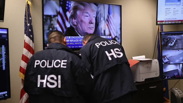 Homeland Security Investigations ICE agents work in a control center.