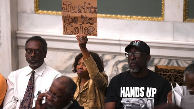 Demonstrators gather in the council chamber to protest in front of councilmen and councilwomen at Philadelphia City Hall on June 20th, 2019, in Philadelphia, Pennsylvania. Philadelphia police have confirmed that more than 70 officers have been placed on desk duty while authorities investigate alleged racist and violent social media posts that were unearthed by the Plain View Project.
