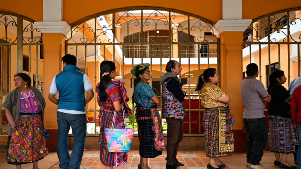 Locals line up to vote at a polling station in San Pedro Sacatepuez, Guatemala, on June 16th, during general elections. Corruption-weary Guatemalans were set to elect a new president Sunday after a tumultuous campaign that saw two leading candidates barred from taking part and the top electoral crimes prosecutor forced to flee the country, fearing for his life.
