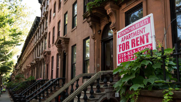 A sign advertises an apartment for rent along a row of brownstone townhouses in the Fort Greene neighborhood in the Brooklyn borough of New York City.