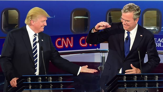 Republican presidential hopefuls Donald Trump and Jeb Bush share a moment during the Republican Presidential Debate at the Ronald Reagan Presidential Library in Simi Valley, California, on September 16th, 2015.