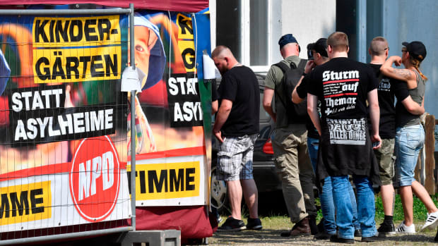 """Participants queue up to enter the Neisseblick Hotel where the """"Schild und Schwert"""" (Shield and Sword) neo-Nazi festival is taking place, in the small eastern German town of Ostritz, on April 21st, 2018."""
