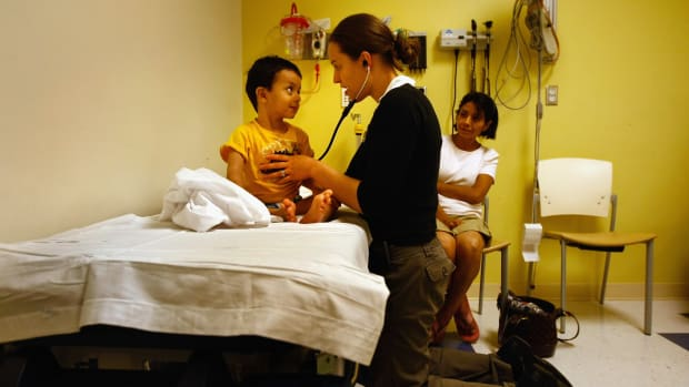 A nurse checks a child's heartbeat in the emergency room of the Children's Hospital in Aurora, Colorado.
