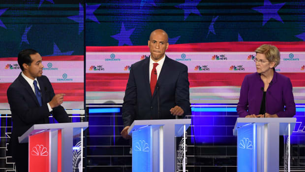 Democratic presidential hopeful and former Secretary of Housing and Urban Development Julián Castro (left) speaks as New Jersey Senator Cory Booker and Massachusetts Senator Elizabeth Warren listen during the first Democratic primary debate of the 2020 presidential campaign season at the Adrienne Arsht Center for the Performing Arts in Miami, Florida, on June 26th, 2019.