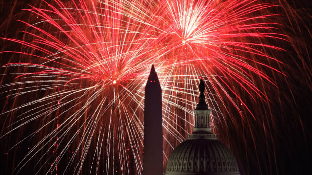 The U.S. Capitol and the Washington Monument are seen as fireworks explode above the nation's capital on July 4th, 2018, in Washington, D.C.