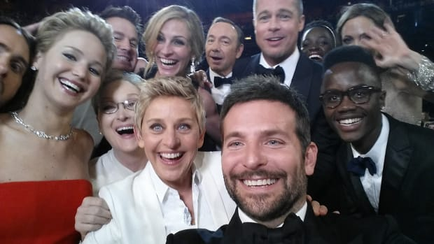 Ellen DeGeneres poses for a selfie taken by Bradley Cooper with (clockwise from L-R) Jared Leto, Jennifer Lawrence, Channing Tatum, Meryl Streep, Julia Roberts, Kevin Spacey, Brad Pitt, Lupita Nyong'o, Angelina Jolie, Peter Nyong'o Jr., and Bradley Cooper during the 86th Annual Academy Awards at the Dolby Theatre on March 2nd, 2014.