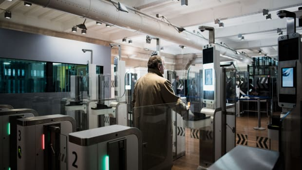 A passenger uses his biometric passport at an automated ePassport gate equipped with a facial recognition system at the British border of the Eurostar at the Gare du Nord in Paris on February 17th, 2017.