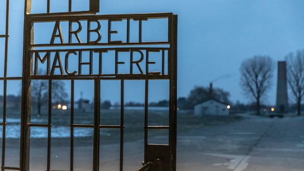 """A gate with the inscription """"Work Sets You Free"""" at the Sachsenhausen concentration camp memorial on January 25th, 2019, in Oranienburg, Germany. Starting in 1936, the Sachsenhausen facility was used by the Nazis, initially for political prisoners, then later also for Jews and other religious minorities, homosexuals, and Soviet prisoners of war."""