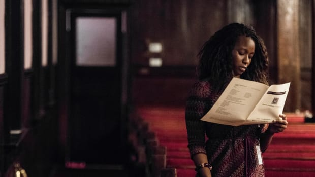 A woman reads a program during a memorial service honoring the victims of the mass shooting at Emanuel African Methodist Episcopal Church, a year after the massacre, on June 17th, 2016, in Charleston, South Carolina.