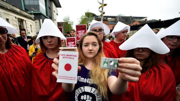 Eleanor Crossey Malone displays an abortion pill packet in Belfast, Ireland.