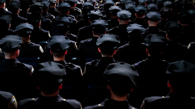 Members of the New York City Police Department attend their police academy graduation ceremony on March 30th, 2017.