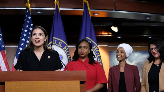 Representative Alexandria Ocasio-Cortez (D-New York) speaks as Representatives Ayanna Pressley (D-Massachusetts), Ilhan Omar (D-Minnesota), and Rashida Tlaib (D-Michigan) listen during a press conference at the U.S. Capitol on July 15th, 2019, held in response to Donald Trump's tweets.