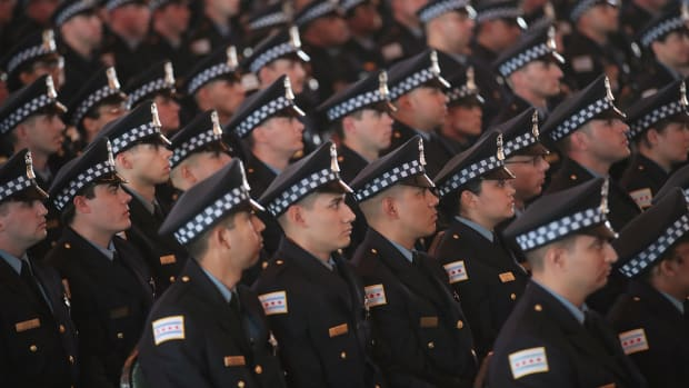 Chicago police officers attend a graduation and promotion ceremony in June of 2017.