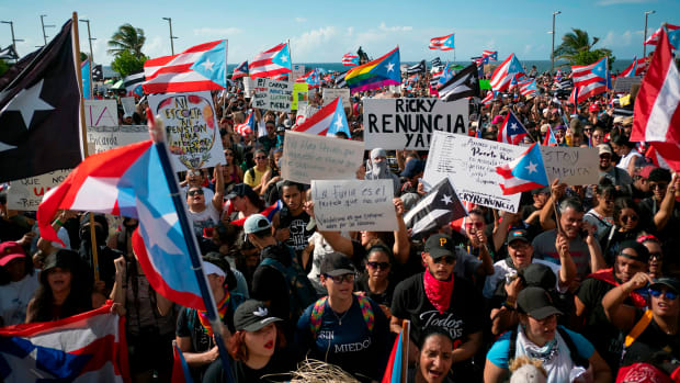 People take part in a demonstration demanding Governor Ricardo Rossello's resignation in San Juan, Puerto Rico, on July 17th, 2019.