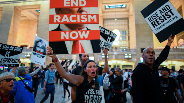 Protesters wave placards against President Donald Trump during a Rise and Resist Against White Supremacy demonstration inside the Grand Central Station in New York on September 18th, 2017.