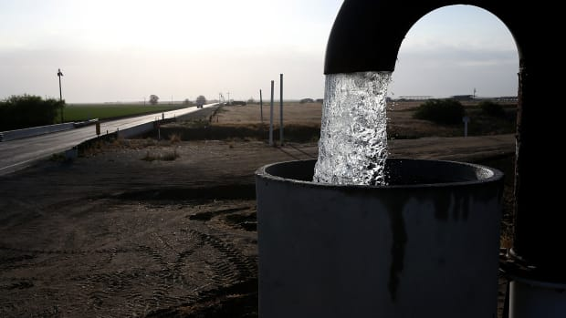 Well water is pumped from the ground on April 24th, 2015, in Tulare, California.